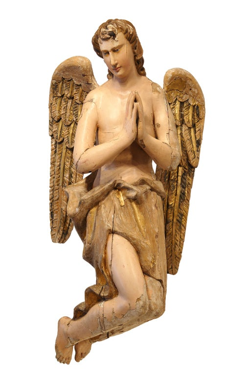"Superb pair of nativity angels. Wood carved with layers of original paint and gesso. Found in a church attic in Belgium. Fantastic craftsmanship and emotion. One angel is 41"" tall x 22"" wide x 22"" deep. The other is 42"" tall x 26"" wide x 14"" deep."