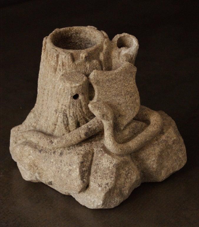 American folk art limestone carving snake shield and