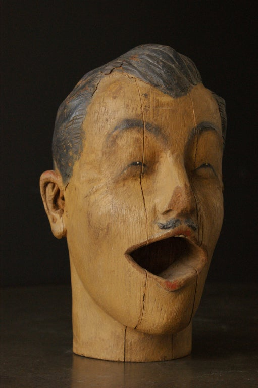 Finely featured carved man's head found in the southern United States. Most likely a late 19th century carnival head featured in a ball or ring toss game.