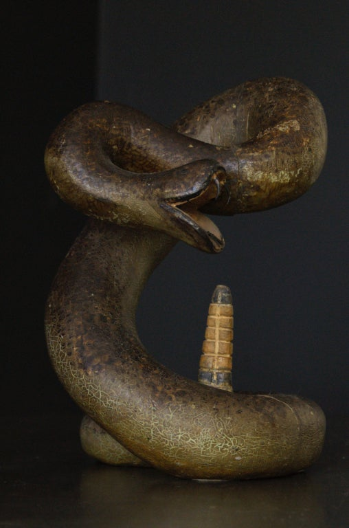 Excellent American Folk Art carved rattle snake. Posed to strike. Great carving detail from the rattlers to the fangs. Superb original paint surface showing perfect age and alligatoring. Constructed and carved from four pieces of wood. Please see