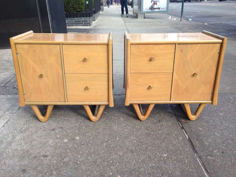 Pair of two-drawer with side storage compartment Mid-Century Modernend side or lamp tables with V legs.