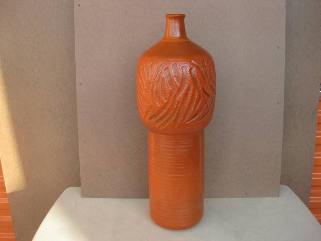 Signed Terra Cotta Red colored Japanese tall Mid-Century Modern ceramic vase, single lamp base, this burnt orange vase can be wired for a table lamp, we provide rentals for stylists, photo shoot and props for movie sets.