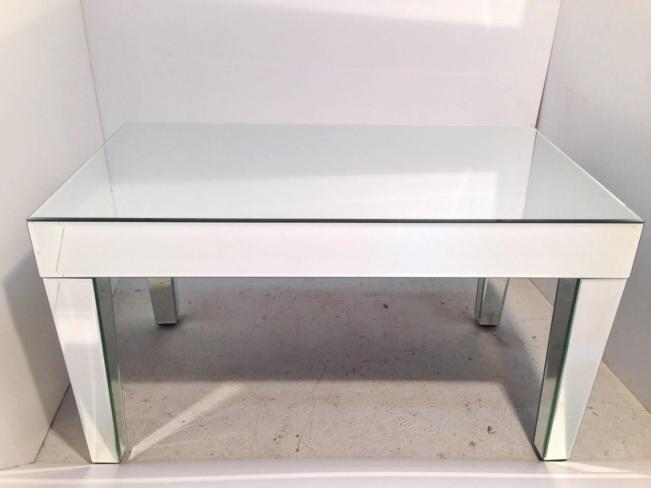 Pair of large or long and narrow mirror clad end, side or cocktail tables.