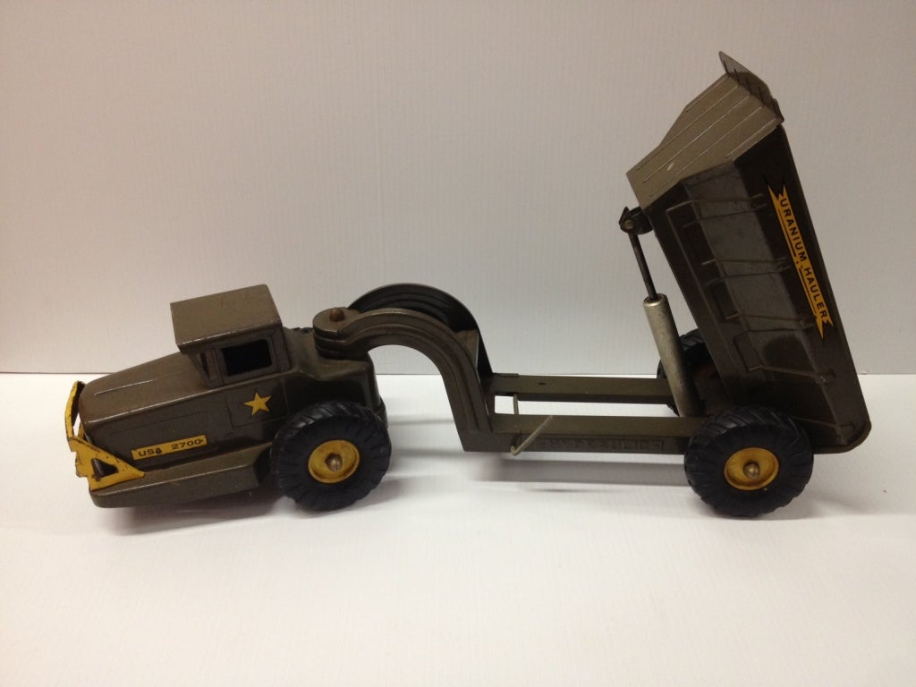 Cold war hydraulic metal United States uranium Hauler Army tractor, trailer and dump truck, an outstanding Christmas gift or present.  This item is now on sale for a clearance price due to inventory liquidation.