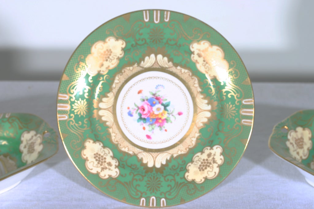 An English crown Staffordshire cake stand and two side dishes. Dishes: 1 3/4