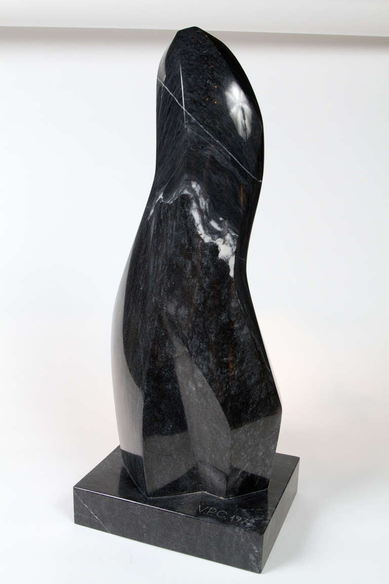 Abstract figure of a cloaked woman in marble. Initialed