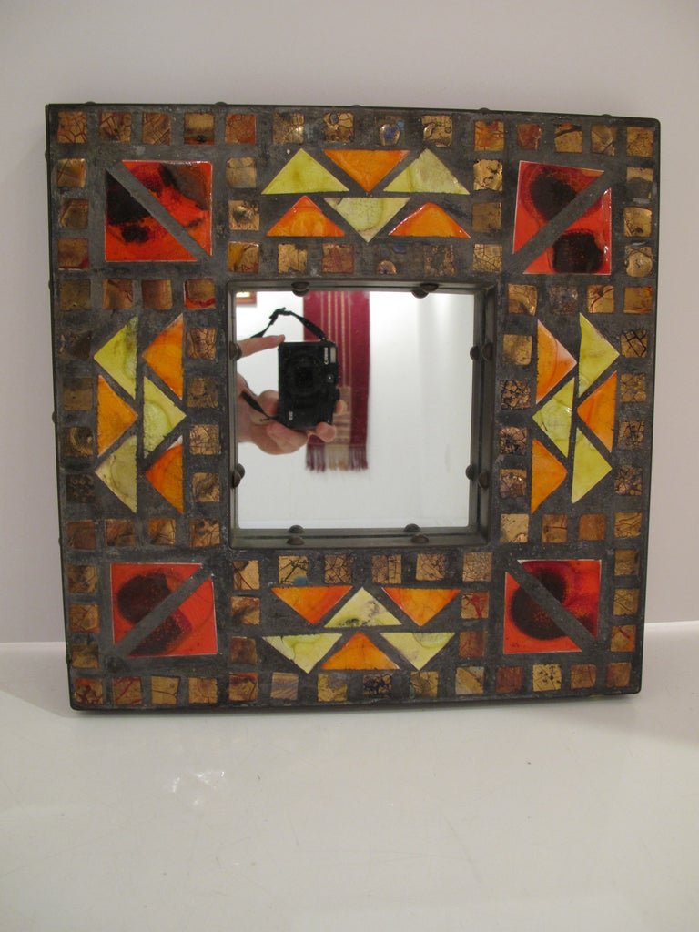 Small colorful brass and ceramic tile mosaic mirror.