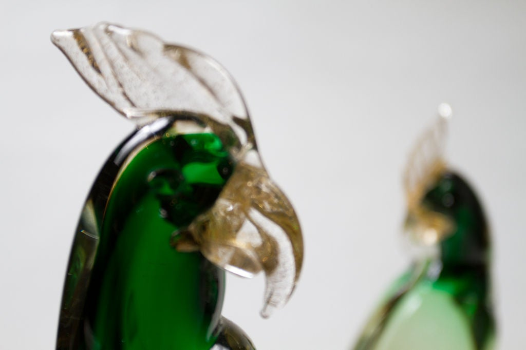 Beautiful green Murano glass sculpture with gold speckle of two parrots resting on a branch, Italy, circa 1960.