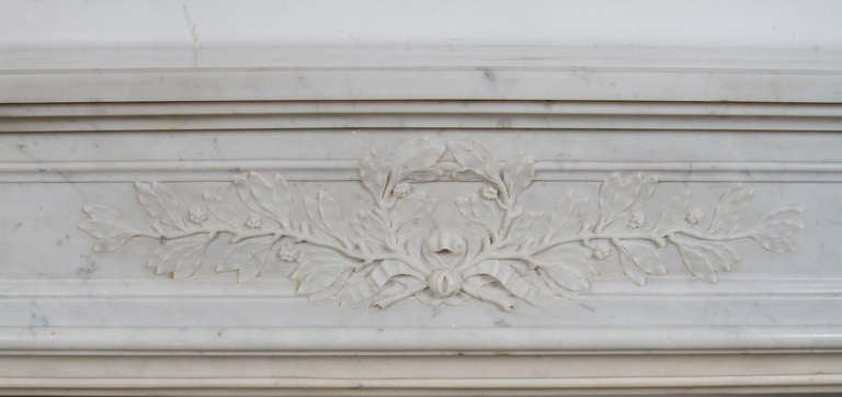 White Carrara marble Louis XVI style marble mantle.   Interior dimensions: W: 40