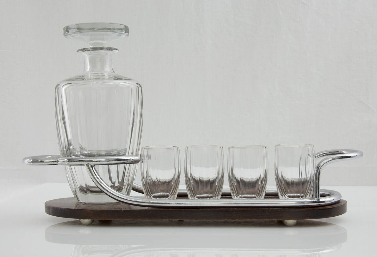 """Fabulous Art Deco bar set comprising a crystal decanter, four cordial glasses and mohagany and silver handled serving tray. Approximate sizes: Tray: 16"""" long x 5"""" wide; decanter: 8.25"""" high; glasses: 2.75"""" high, France, circa 1920s. Classic and"""