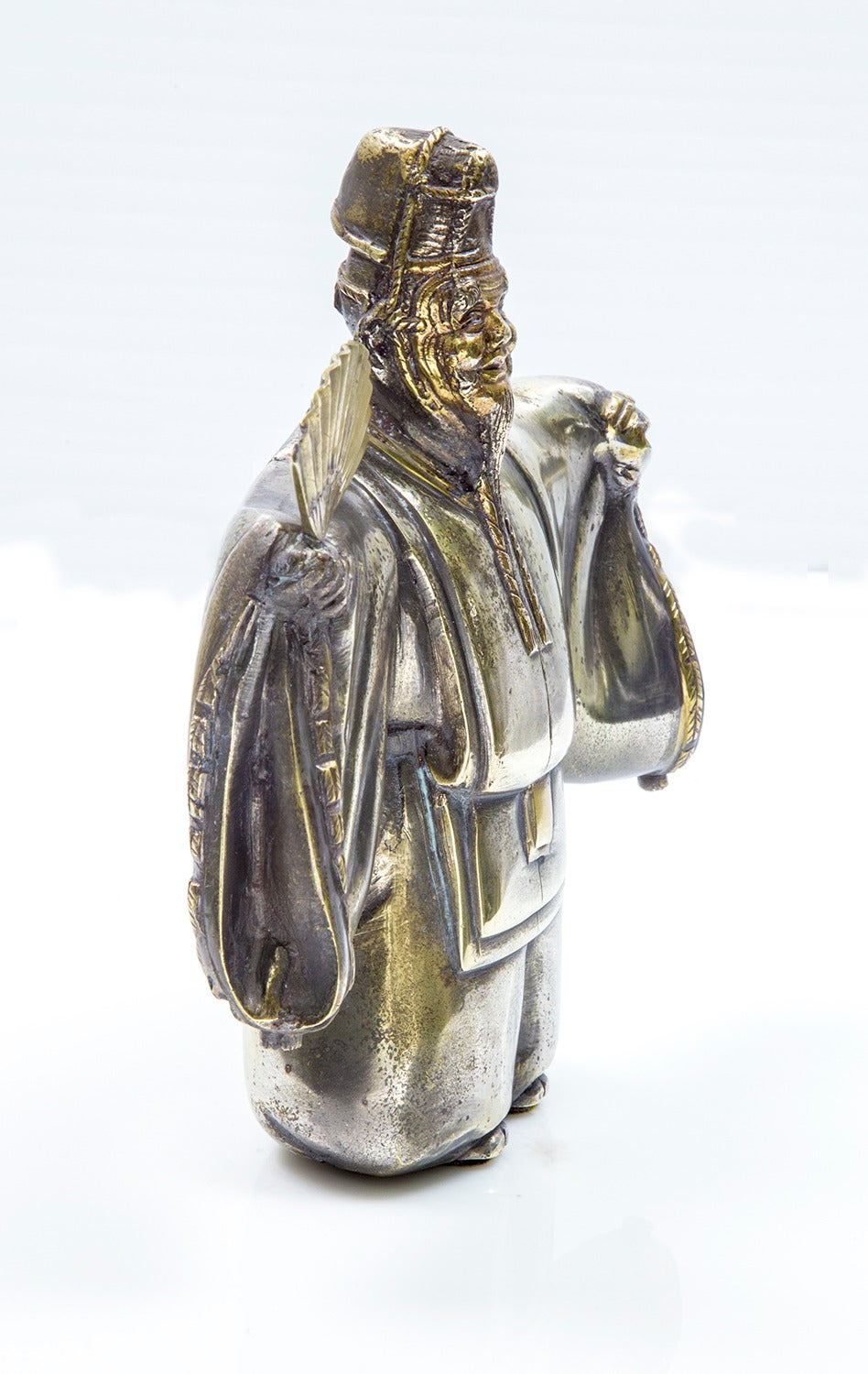 Mid-late 20th century bronze sculpture of the traditional Japanese theater, modeled as a Japanese classical gentleman dancer holding a fan, wearing a robe with embroidered trim in relief, gilt accents, unsigned. Measures: 7.5