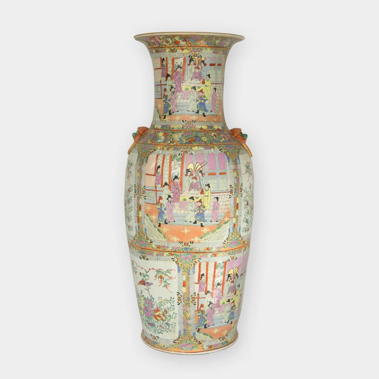 Beautifully hand decorated Imperial size baluster shaped Chinese porcelain palace vase with alternating panels depicting palace figures within courtyard and pavilion with birds and floral designs and palace scenery all surrounded by a profusion of