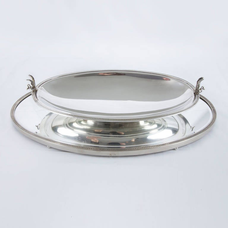 "Beautiful Edwardian sterling silver center piece, featuring an oval footed bevel mirrored plateau and bowl with swan handles on each end; marked: 925 and makers' mark; plateau measures: 17.5"" x 10.25"" x 1"" high; low pedestal bowl; 14"" x 7.5"" x 2"""