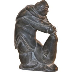 Inuit Sculpture of Hunter Catching Seal