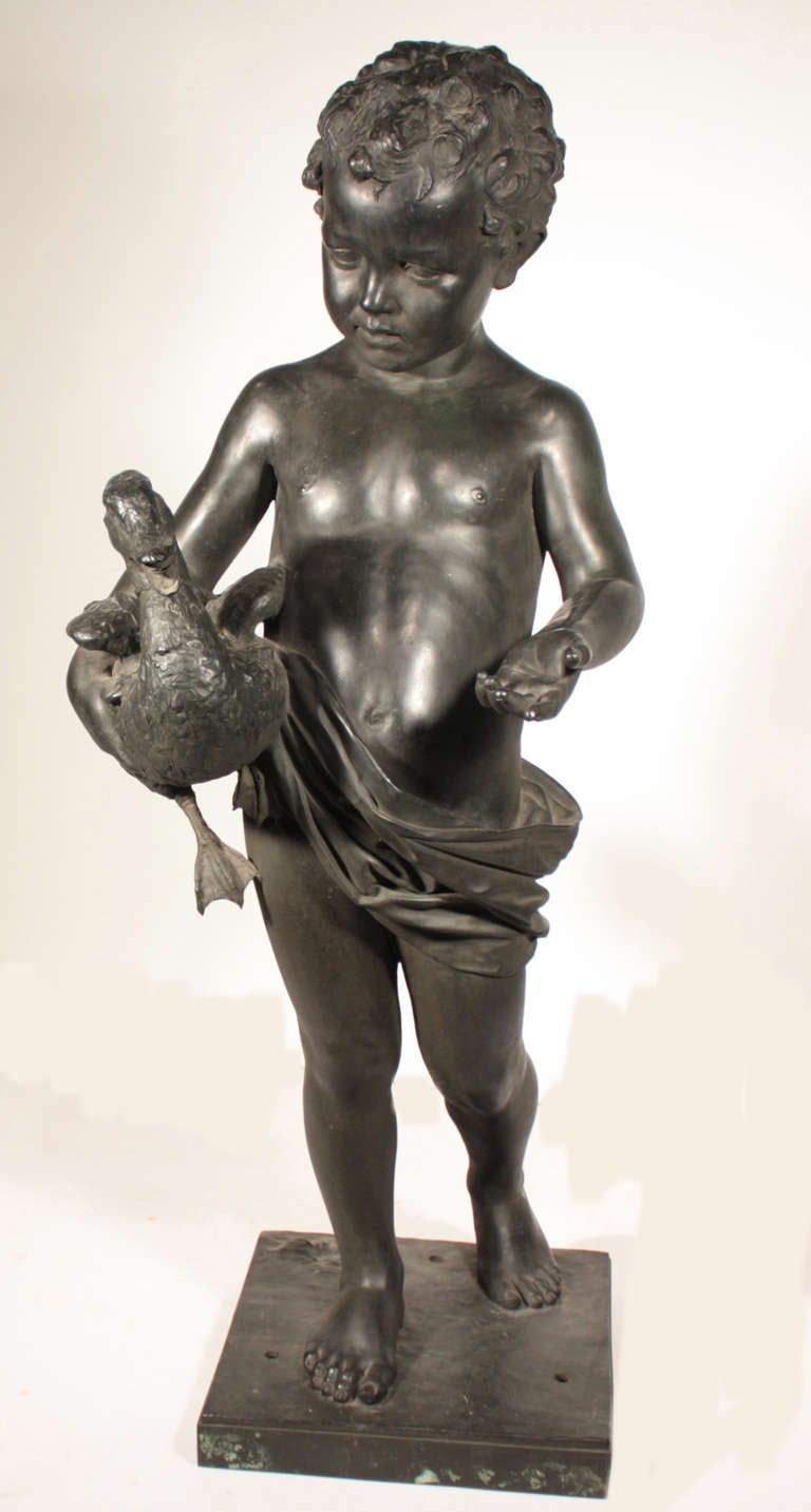 A life-sized antique bronze fountain-head modeled as a boy holding a duck. The water spouts out of the ducks mouth. It would work well simply as a member of a bronze group.  This charming study  was actually displayed in a covered space, a