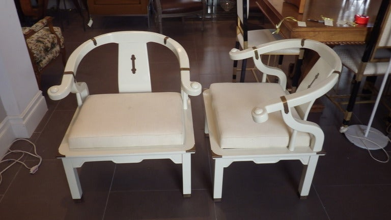 Beautiful pair of chairs in the style of New York, Mid-century designer James Mont.  Frame is wood with white lacquer throughout.  Decorative brass inlay.
