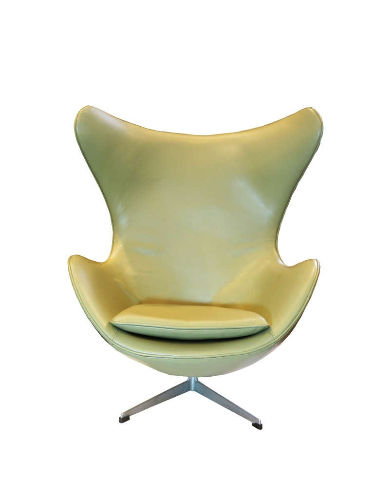 Unique mid-century chair by Arne Jacobsen. THis piece has been recently reupholstered with high quality, hand selected, celery gray leather.