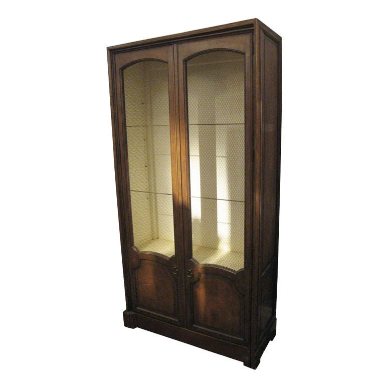 This wonderful large cabinet is outfitted with a subtle wire screen to display whatever your heart desires. The style and color of wood is very Americana.