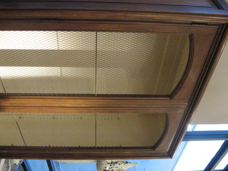 Baker Tall Blonde Wood Cabinet with Wire Screens for Display In Good Condition For Sale In Los Angeles, CA