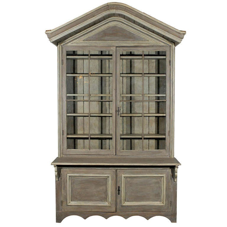 Early 19th Century American Shop Cabinet With Glass Doors And Bonnet