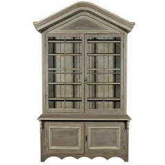Early 19th Century American Shop Cabinet with Glass Doors and Bonnet Top