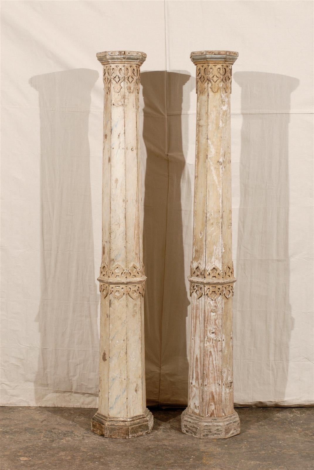 A pair of exquisite European mid-19th century wooden octagonal columns. This pair of wooden slender columns features a delicate and intricate decor which could be reminiscent of the Alhambra in Grenada, Spain. The octagonal base is quite simple, but