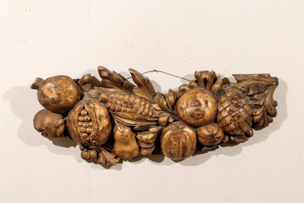 An exquisite turn of the century Italian painted wood architectural fragment depicting various fruits and foliage, such as pomegranates (symbol of life, marriage and rebirth).
