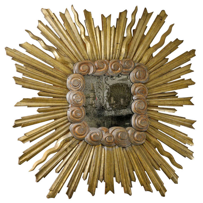 Exquisite Large Size Italian Gilt Sunburst Mirror from the Early 19th Century For Sale