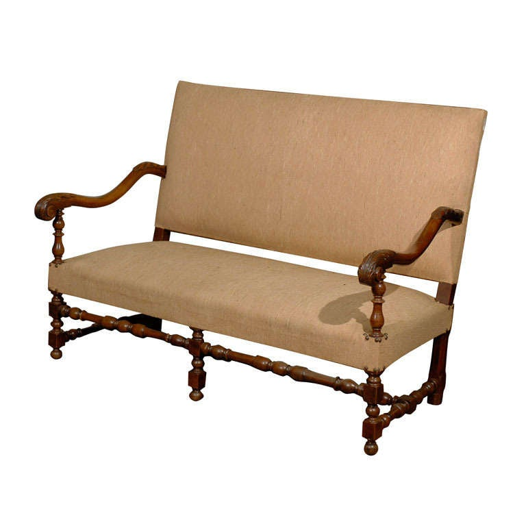 French baroque style upholstered settee with turned legs for French baroque characteristics