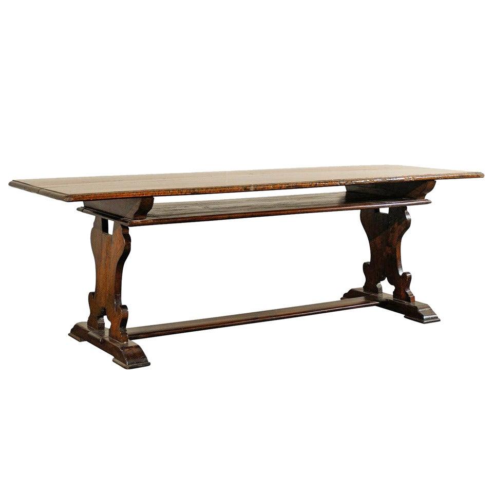 19th century walnut italian monastery trestle dining table for Dining table shelf