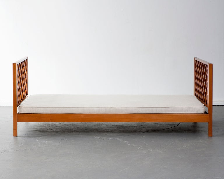 Daybed in pau maufim (ivory wood) with upholstered cushion. Designed by Joaquim Tenreiro, Brazil.