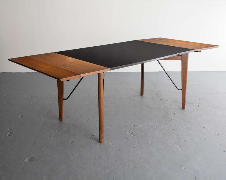 Dining table with extension leaves in walnut and formica. (Extends to 85.5
