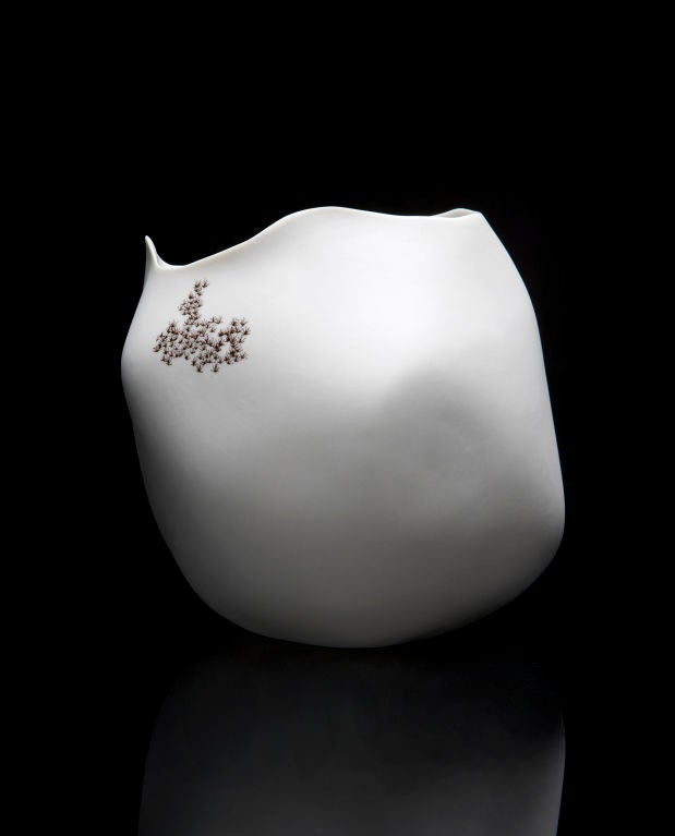 SM4632  Unique rock vase in white porcelain with moss detailing. Designed and made by David Wiseman, USA, 2010.