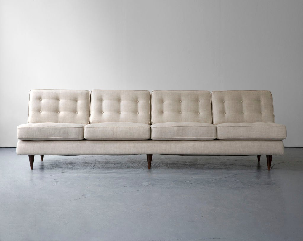 Four-seat sofa in blue upholstery with jacaranda legs. Designed by Joaquim Tenreiro, Brazil, 1950s. Measures: seat: 16