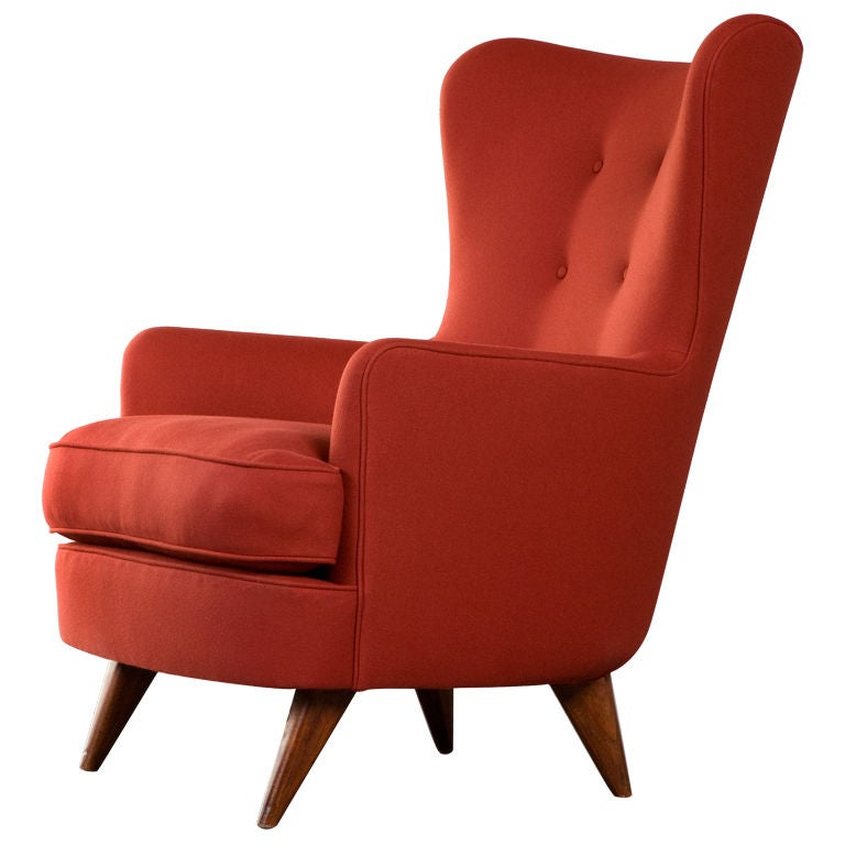 Lounge chair upholstered in red. Designed by Joaquim Tenreiro, Brazil, 1950.