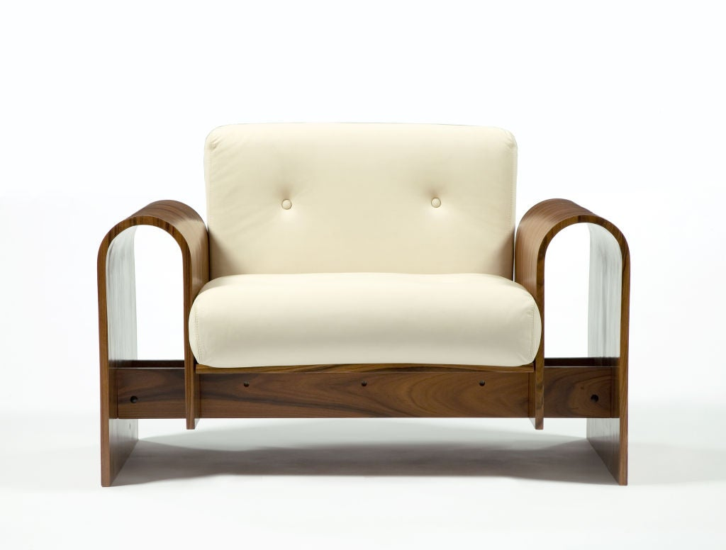 Lounge chair in imbuia wood with bone-colored leather upholstery. Designed by Oscar Niemeyer, Brazil, for the SESC hotel, 1990. Produced in Brazil, 2007.