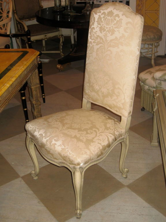 Set of four French high back upholstered painted chairs.
