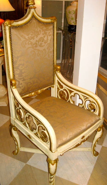 19th century Gothic Revival painted ivory white and gold armchair.
