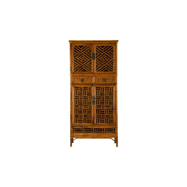 Vintage fretwork cabinet bamboo and brass hardware.