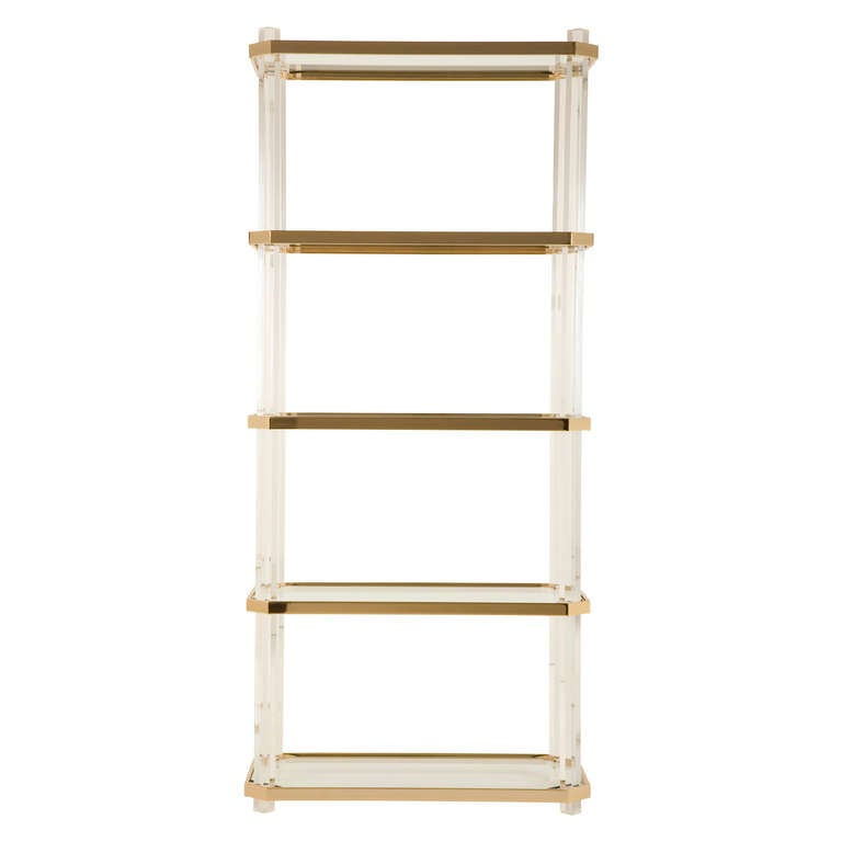 vintage etagere. brass and lucite frame. glass shelves.