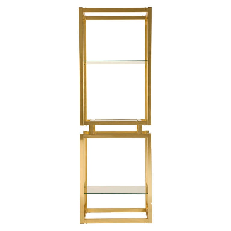vintage etagere. brass frame with glass shelves. pair available (priced individually).