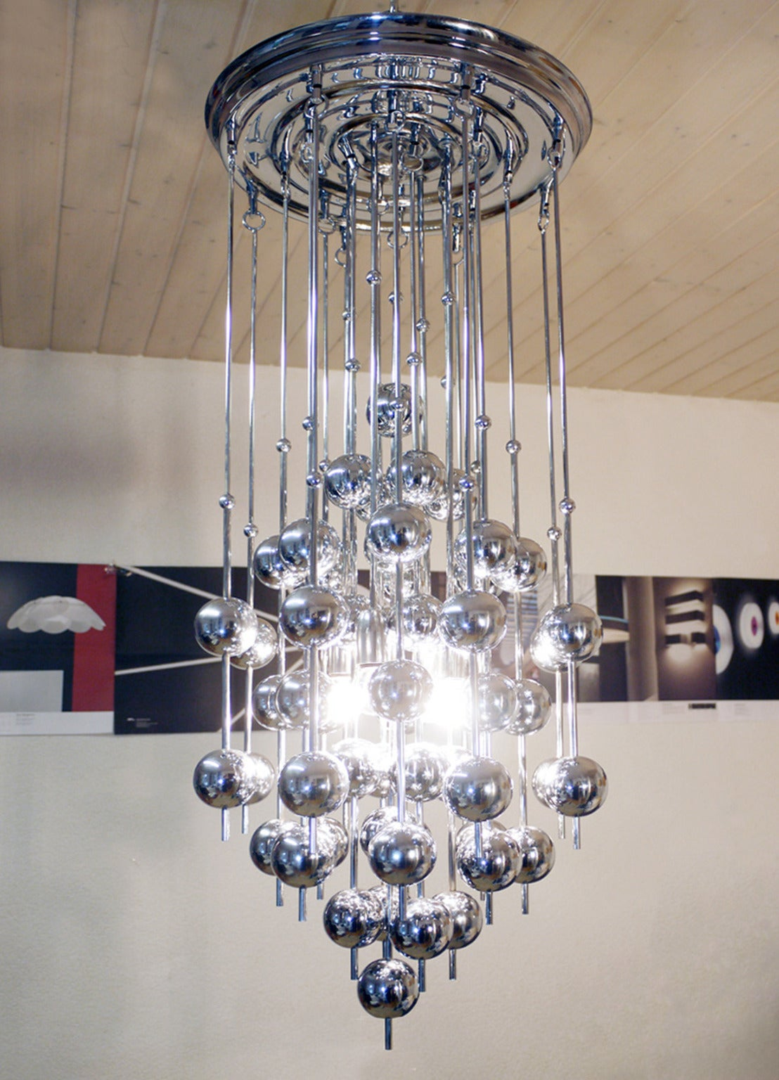 Verner Panton for J. Lüber, a 'Ball' chandelier, designed 1970 formed from a series of chromed metal balls suspended from steel rods.