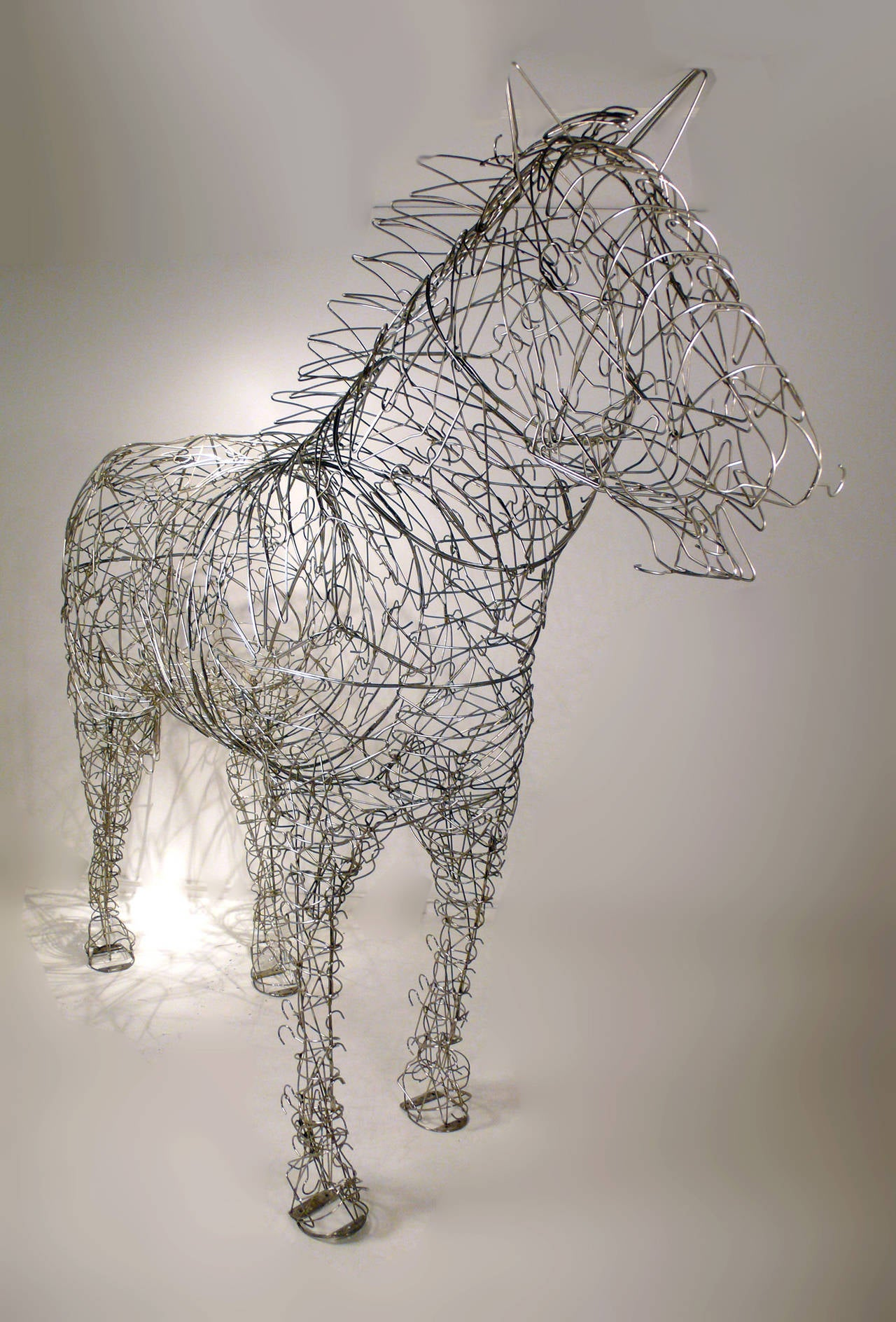 Canadian Massive Horse Sculpture Crafted From 1000 Chrome Coat Hangers for Barneys NY For Sale