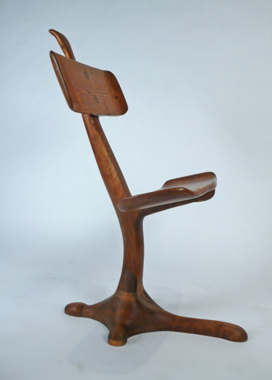 Masterfully constructed hand carved chair-sculpture from the California crafts movement. Possibly one of a kind. Unsigned. Very Much in the style of Wendell Castle.