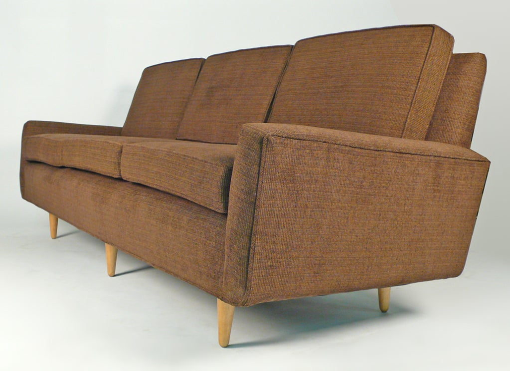 Very early Florence Knoll sofa circa 1950 completely restored including all new 8 way hand tied springs, all new high grade foam cushions and new woven wool upholstery. The solid maple legs have also been re-lacquered. An iconic sofa in showroom