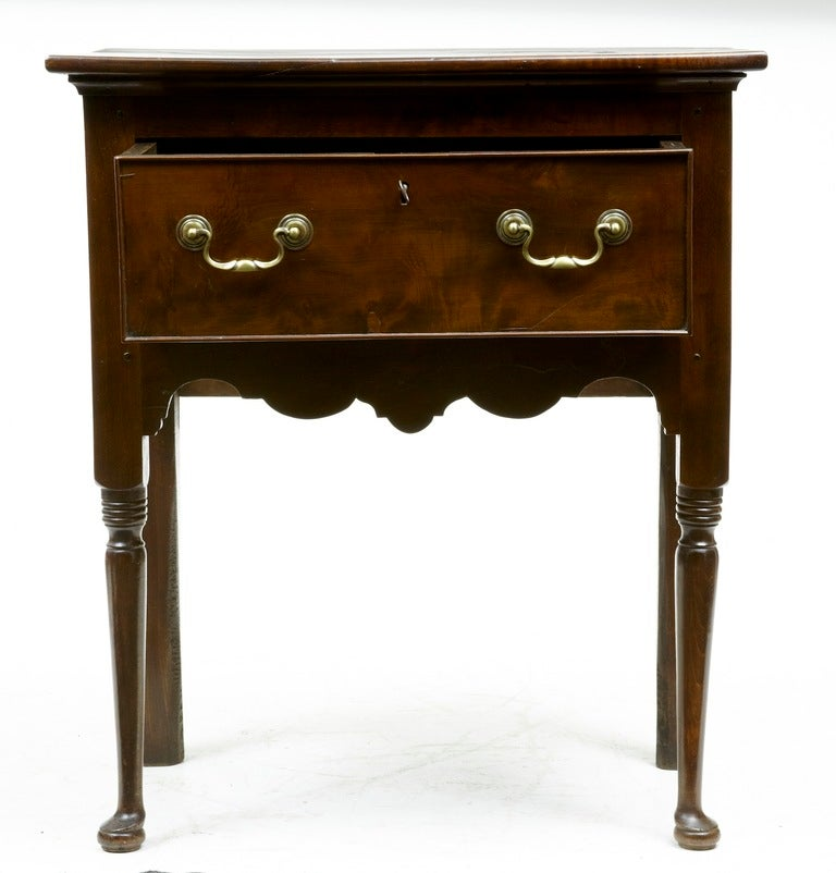Unusual and rare dresser or side table, good patina and one drawer.