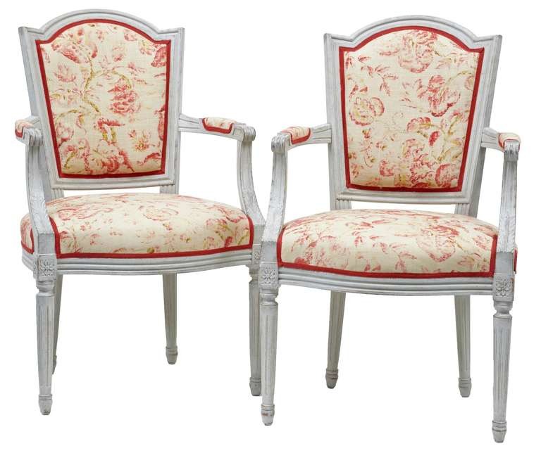 A fine pair of 19th century painted Swedish chairs with carved arm.   Not original upholstery but in good order.   Measures: Height 37