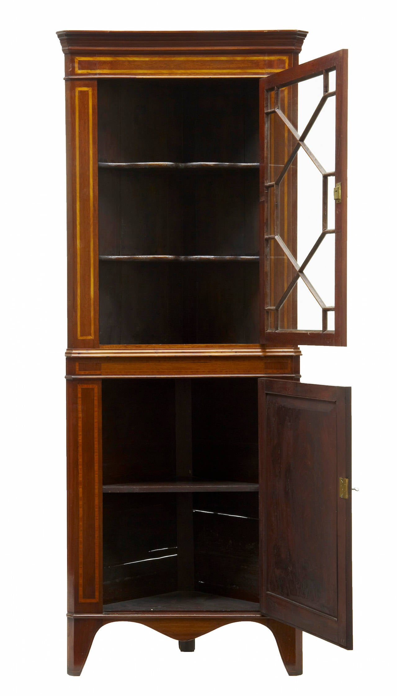 Inlaid mahogany Regency corner cabinet, circa 1820.   Glazed display cabinet to the top containing two shelves, single door below with one shelf.  Measures: Height 73