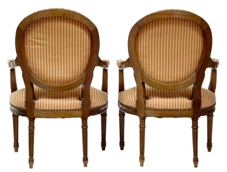 Pair of French walnut open armchairs, circa 1880.