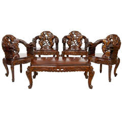 Set of Four Carved Chinese Armchairs with Matching Coffee Table